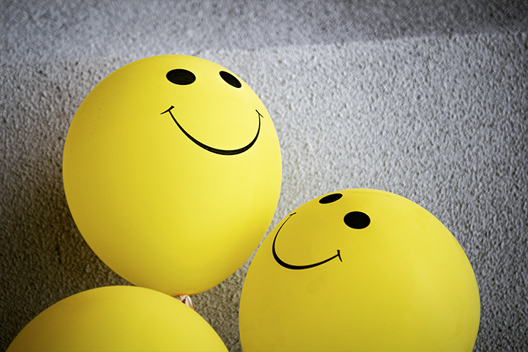 yellow balloons with smiley